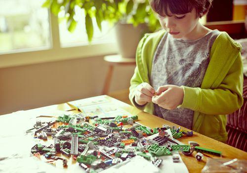 A child sorting legos