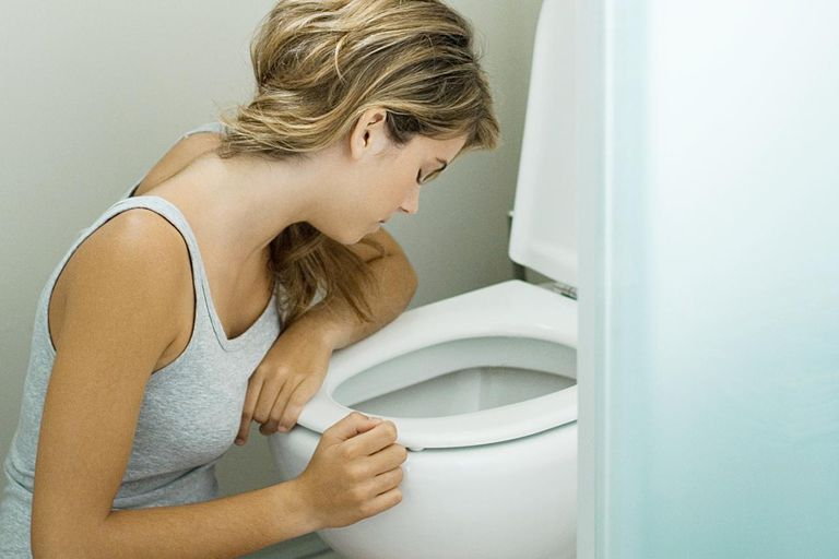 Sick woman in the bathroom.