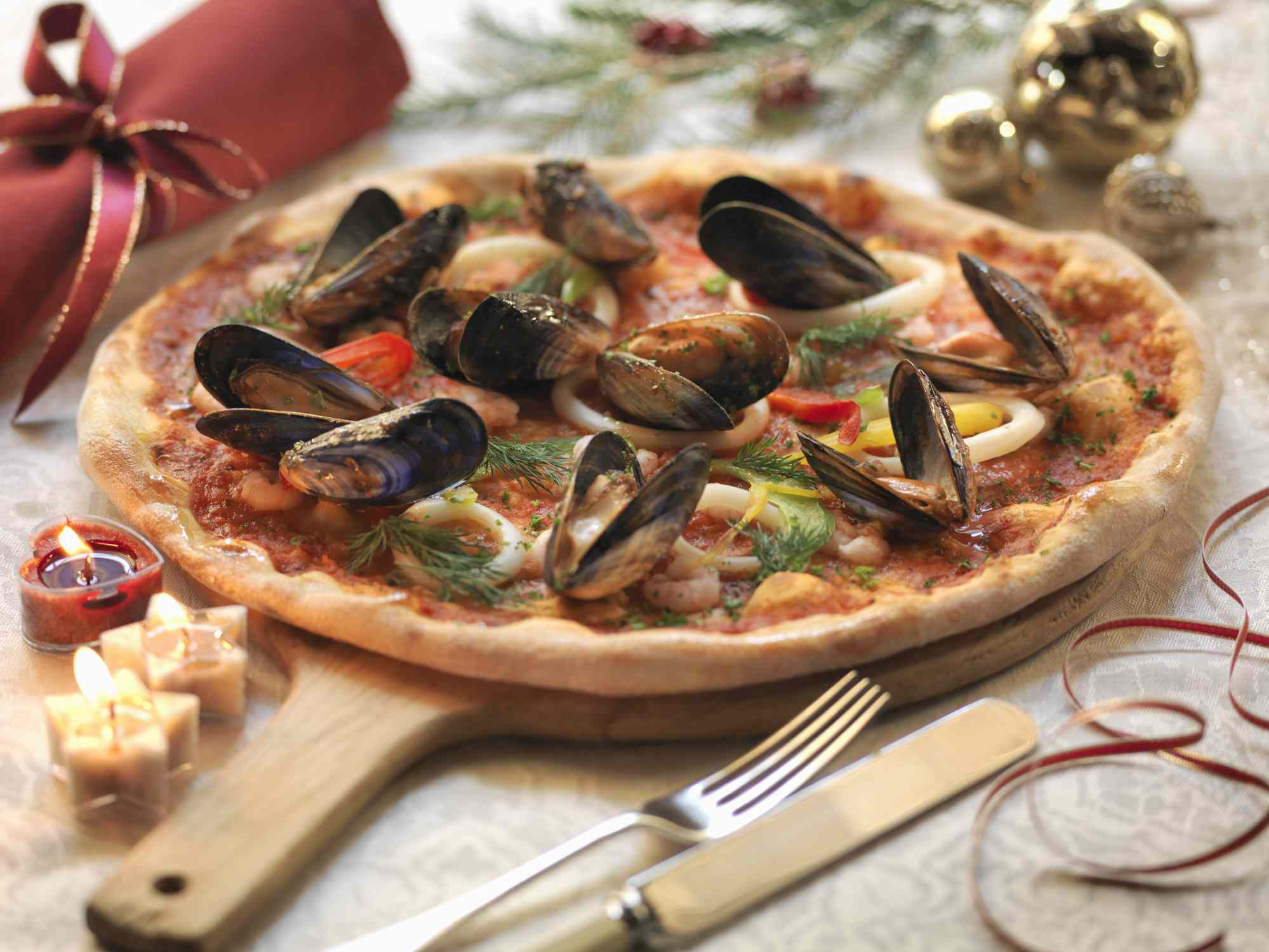 Seafood pizza on a board