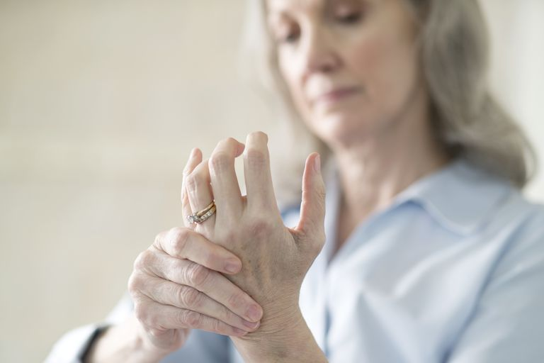 Senior woman holding painful hand