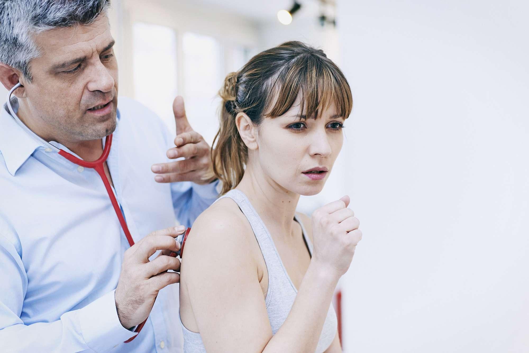 Doctor Auscultating a patient