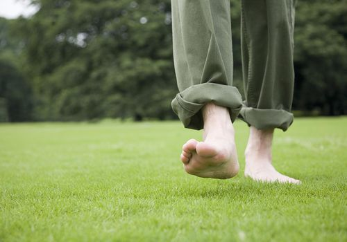 Walking Barefoot on the Grass