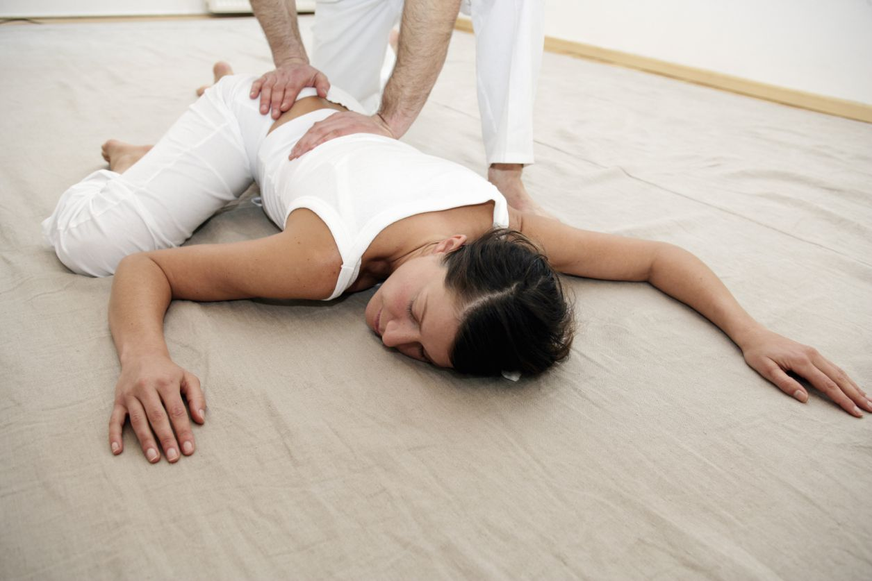 Woman having shiatsu preformed on her