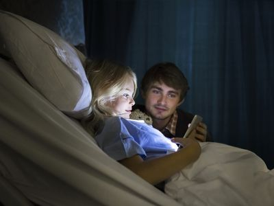 Father and daughter watching a digital tablet