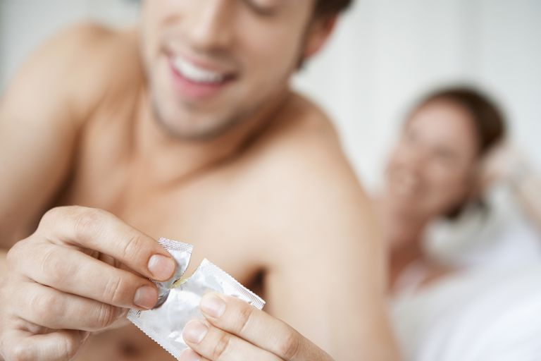 Man opening a condom
