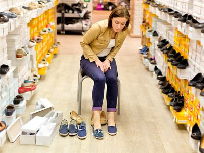 a woman shopping for shoes in a shoe store store