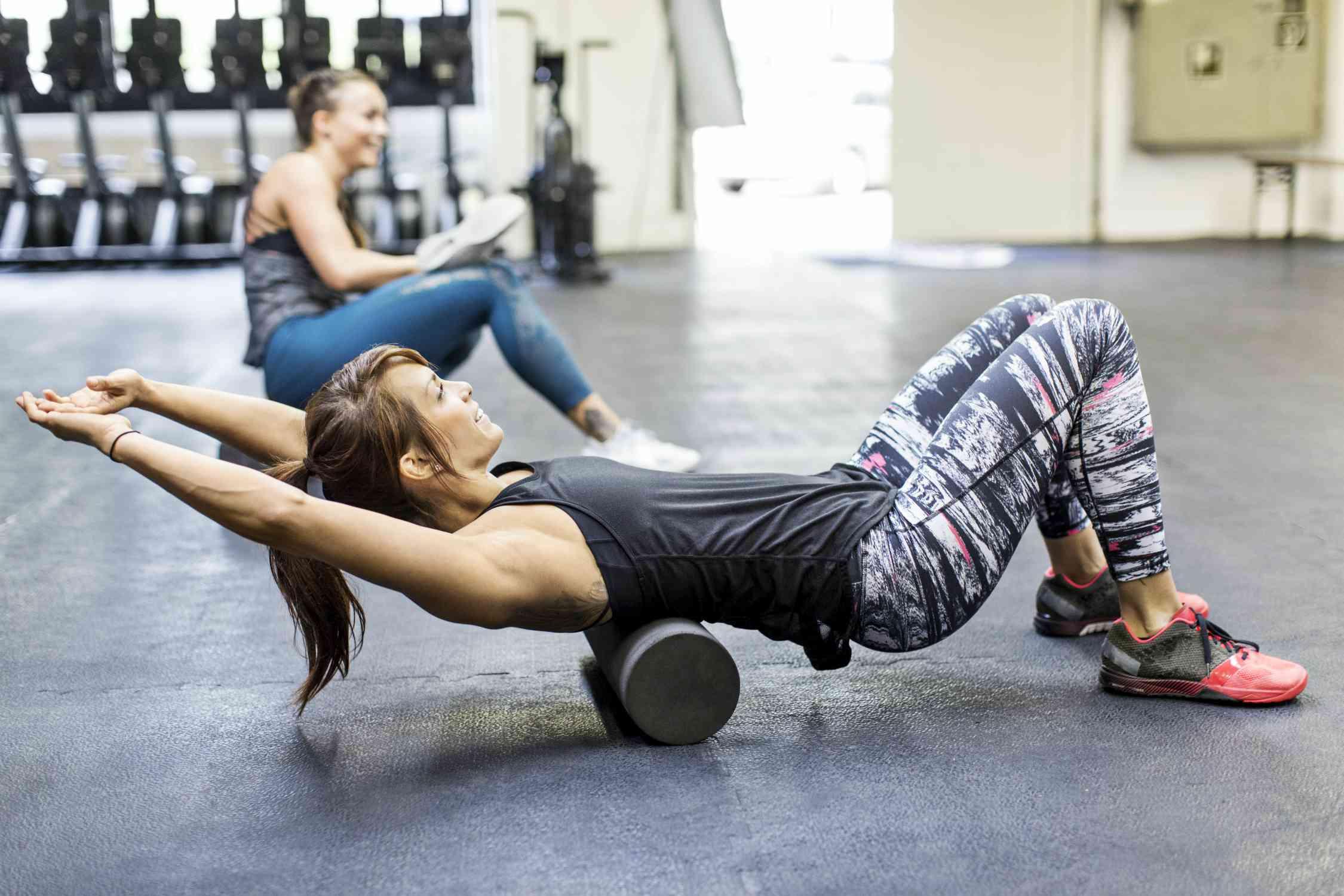 Foam rollingWoman using a foam roller in gym