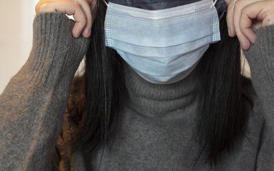 Woman wearing double masks.