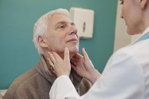 Enlarged lymph nodes on physical exam.