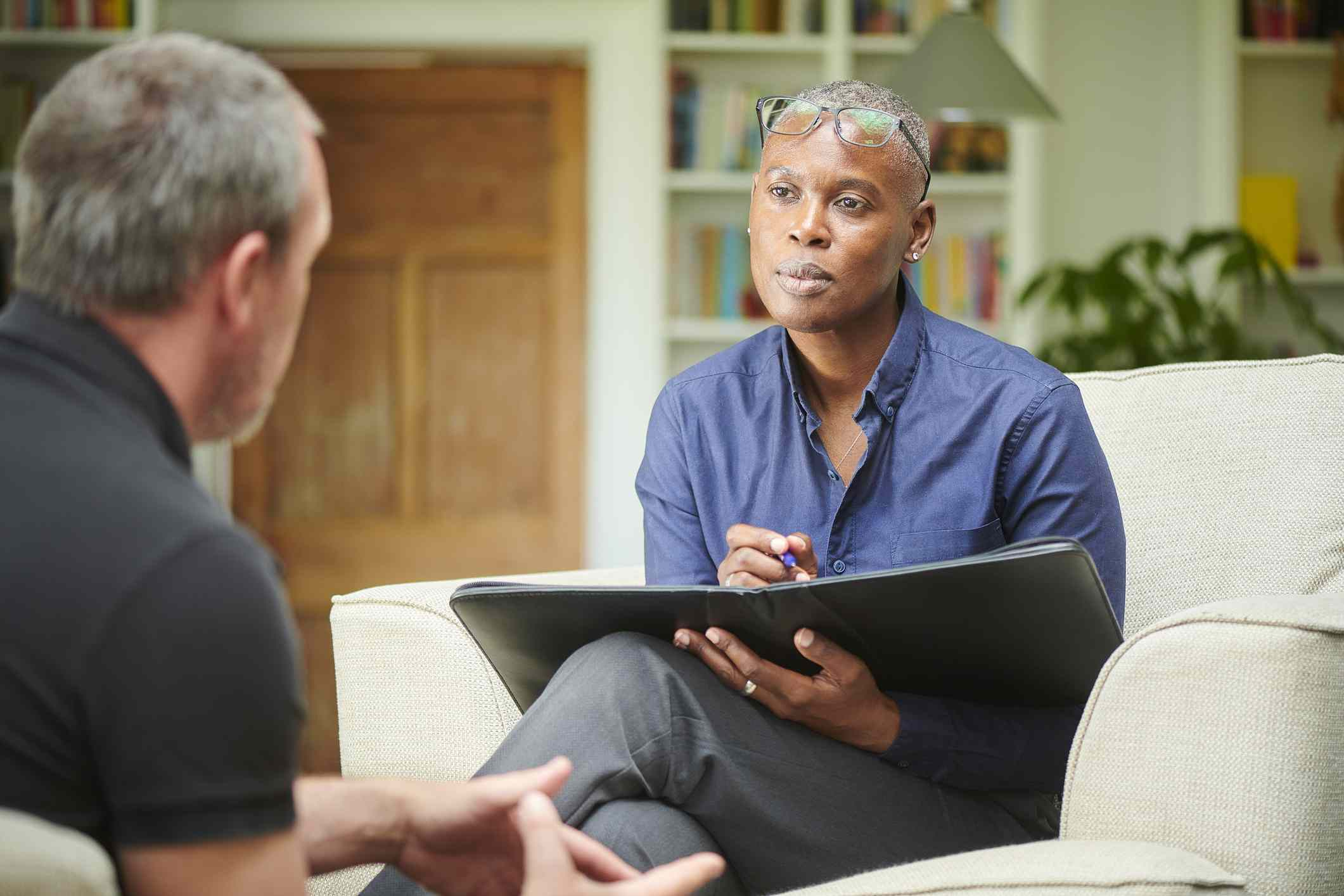Mental health professional talking to client