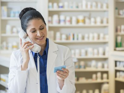 pharmacist talking on telephone