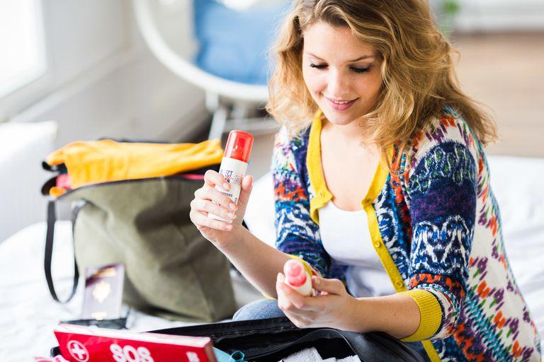 Woman preparing first aid kit.