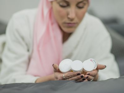 cancer patient looking at her medication