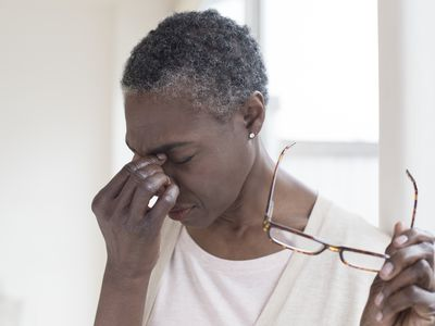 Woman holding her sinuses