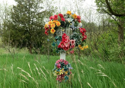 A roadside memorial in a grassy field