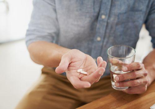Man taking medication.