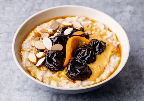 Bowl of oatmeal with prunes
