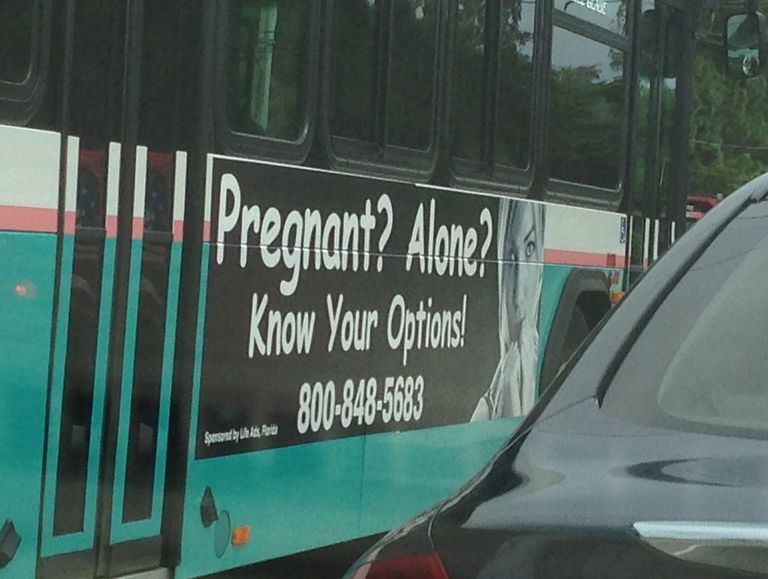 crisis pregnancy center banner on the side of a bus