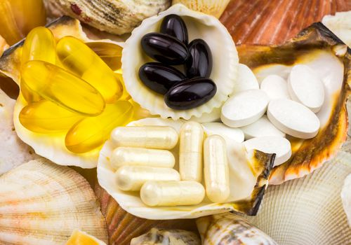Glucosamine tablets on shells