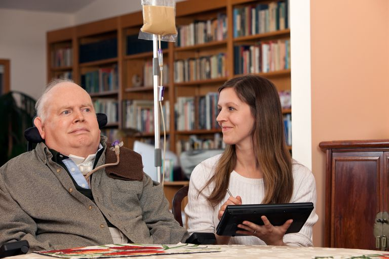 Home Healthcare Nurse and Patient Exchange Smiles