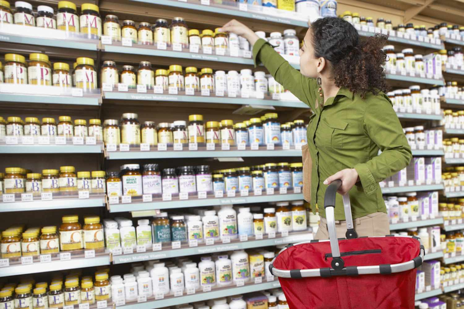 Woman shopping for vitamins - stock photo