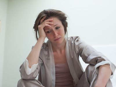A depressed woman with a headache