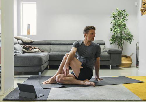 Man exercising at home.