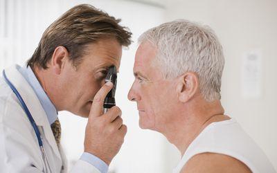 Doctor examining man's eyes