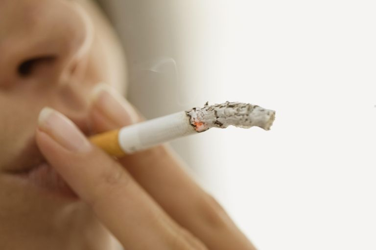 Close up of woman smoking cigarette