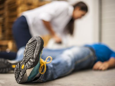 Man laying on the ground in cardiac arrest