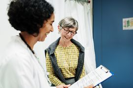 Woman talks to her doctor
