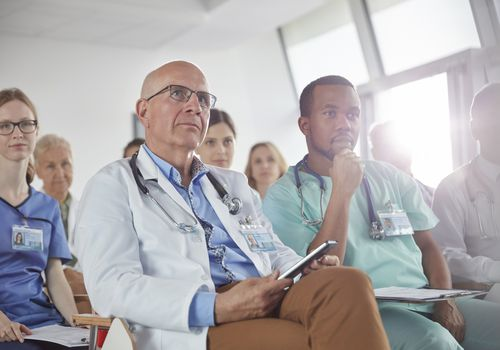 A group of doctors listening in a room together