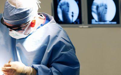 Orthopedic Surgeon Operating On Foot