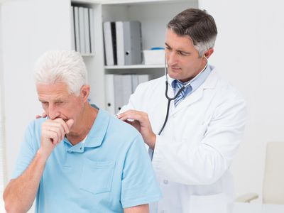 older man coughing pneumonia with doctor