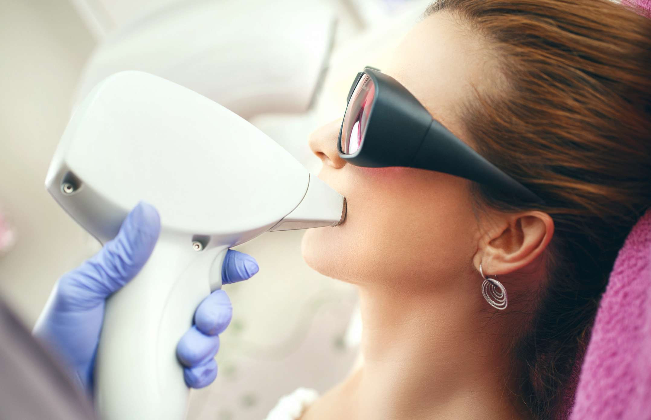 woman getting laser hair removal.