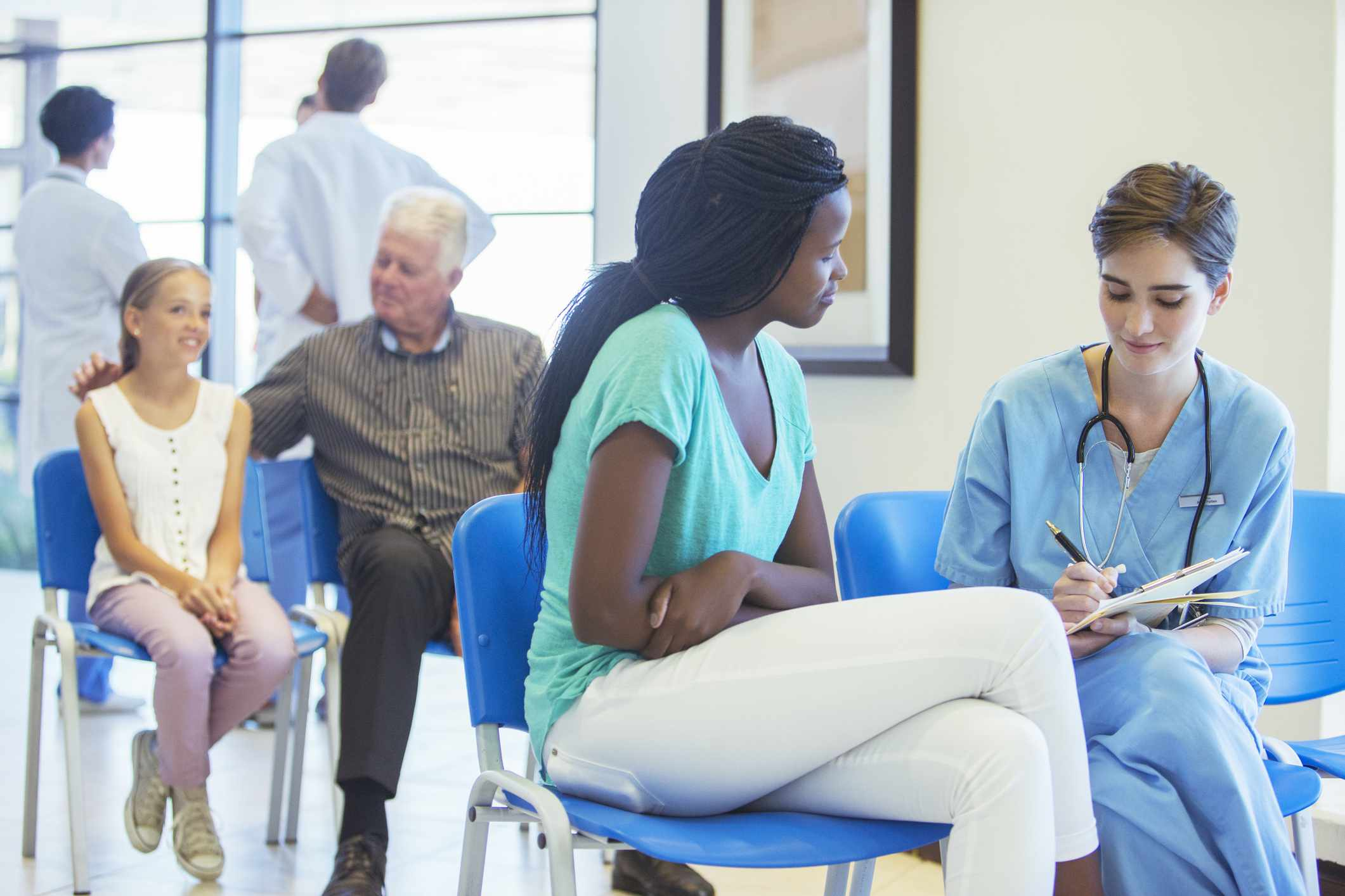 Doctor in Urgent care clinic talks to patient