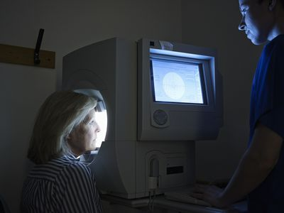 A patient being tested for defects in her visual field