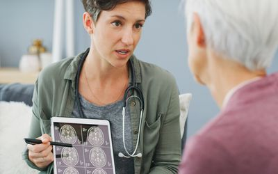 Doctor reviewing brain MRI with patient