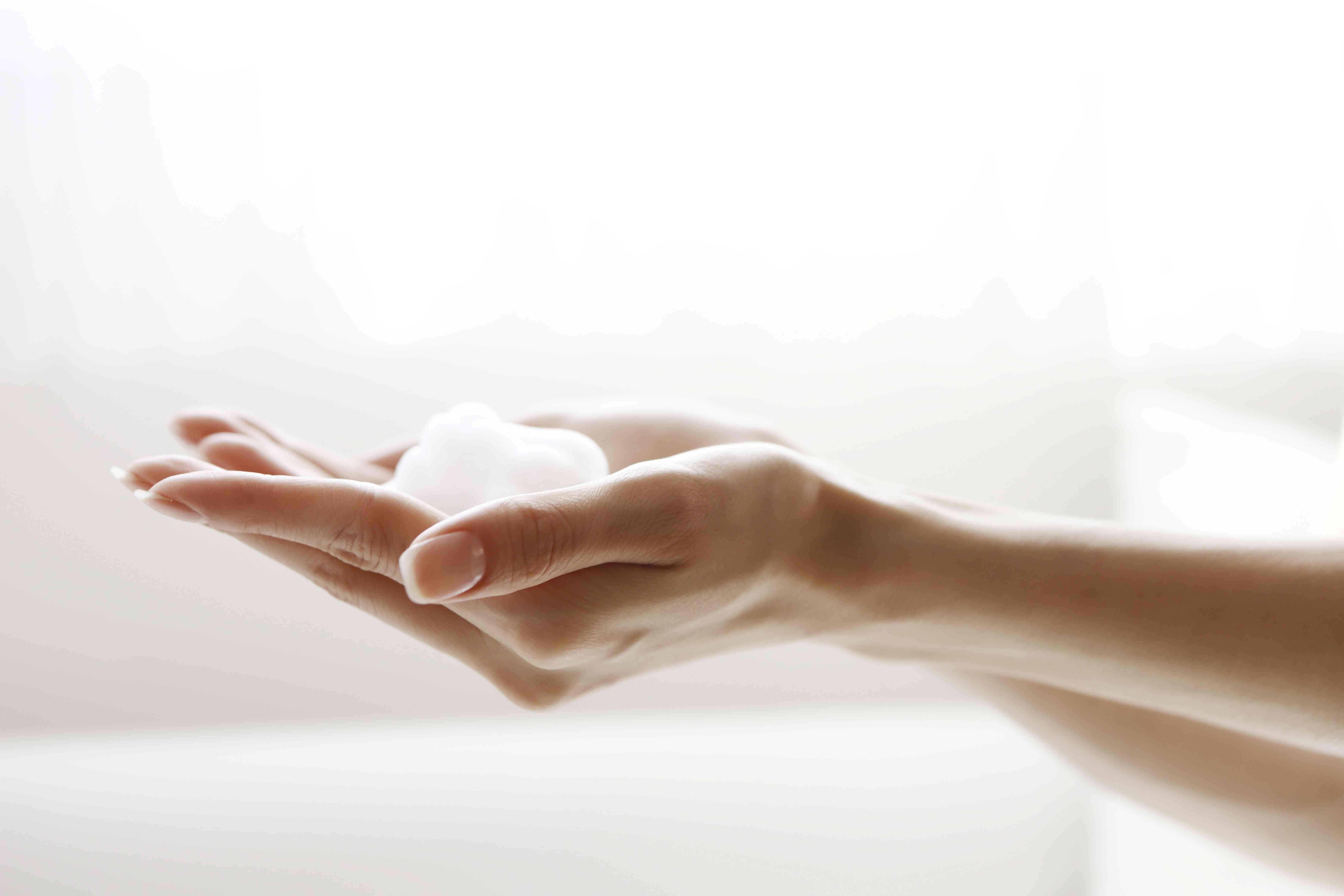 Liquid body soap foam on hands