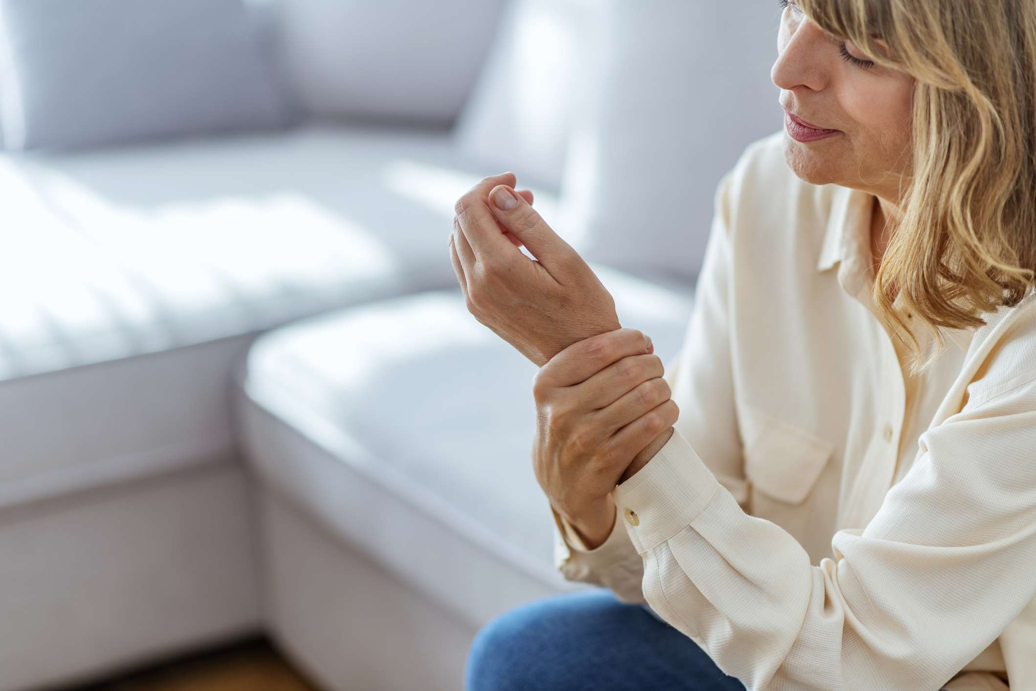 Woman with wrist pain looking at her hand