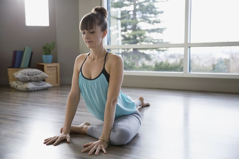 Woman practicing pigeon pose