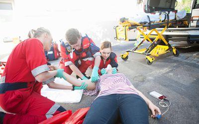 paramedics treating patient