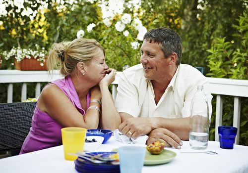 Couple sitting at table outside