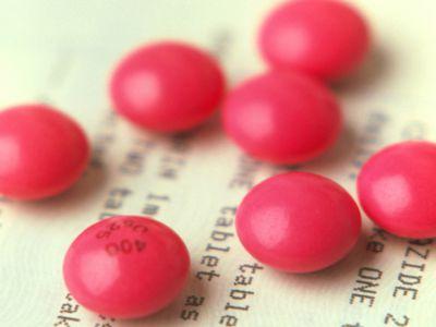 Warfarin pills laying on a sheet of paper