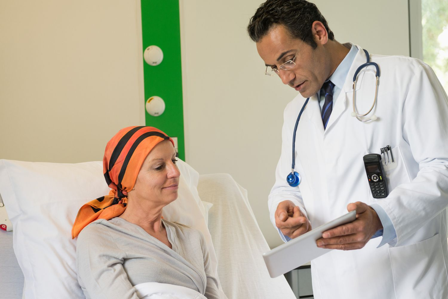 A doctor discusses a report with a patient