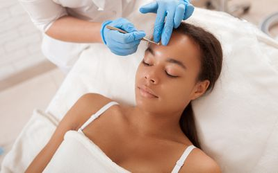Beautiful African woman at skincare clinic