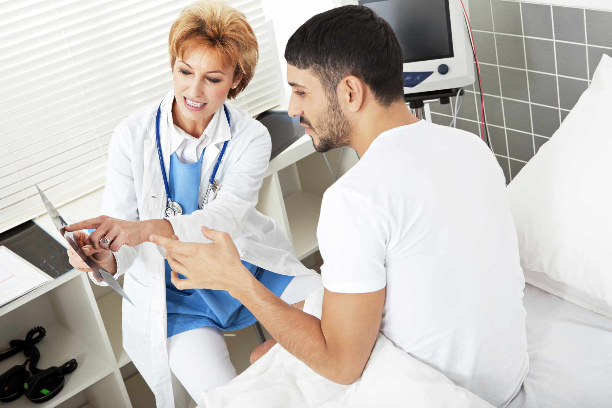 Female doctor explaining MRI exposure to a male patient