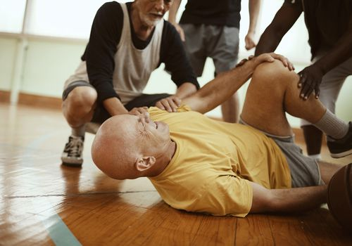 Man falling during a basketball game