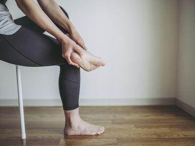 A woman massaging her foot