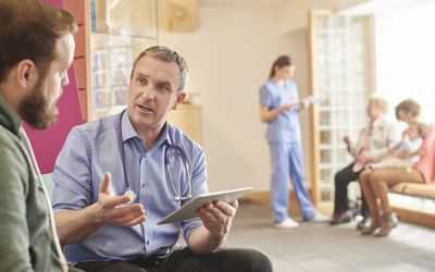 Doctor and Male Patient Discussing Options
